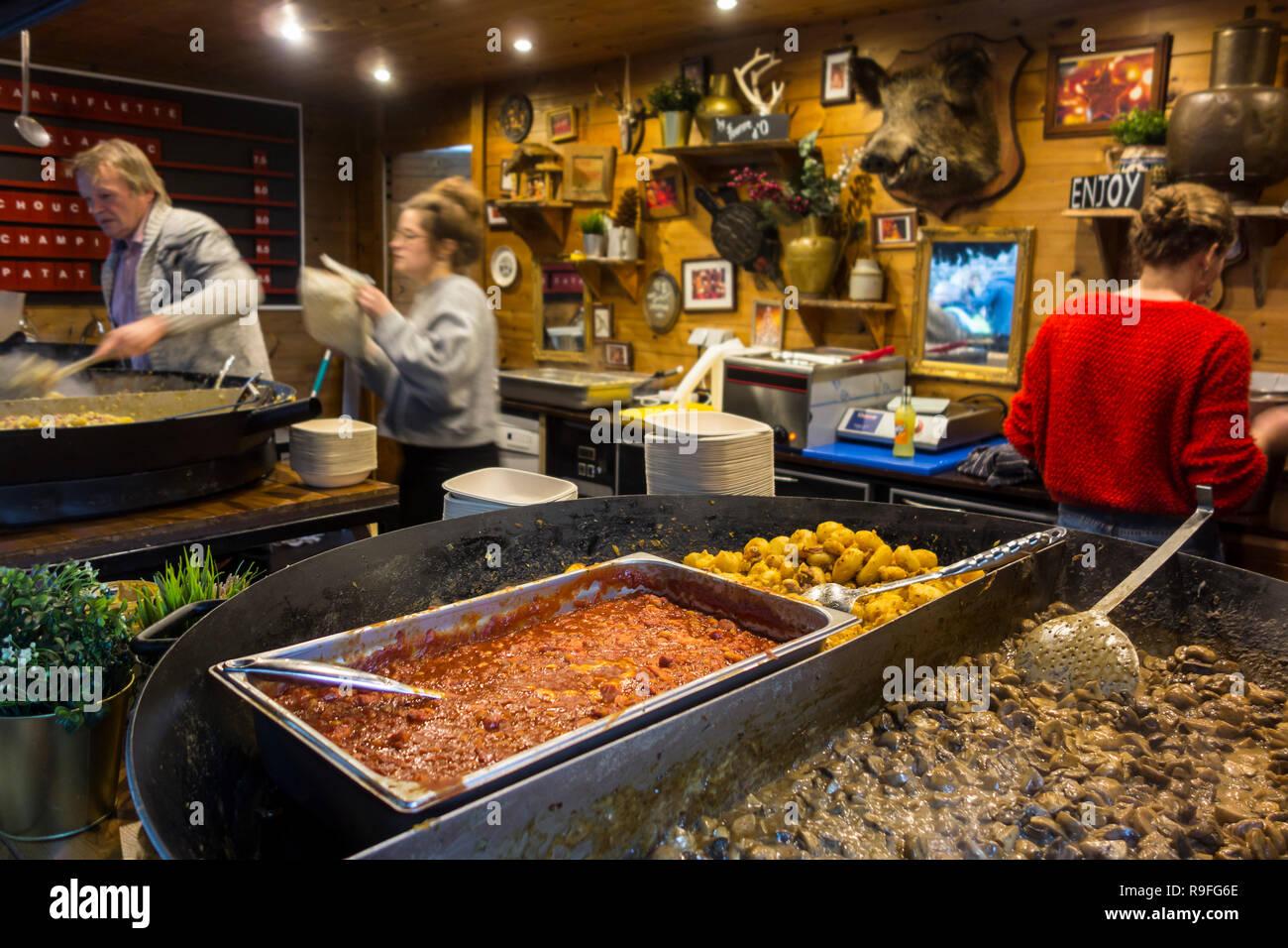 Simmering ingredients in giant pan in food stand at Christmas market in winter in Ghent, Flanders, Belgium - Stock Image