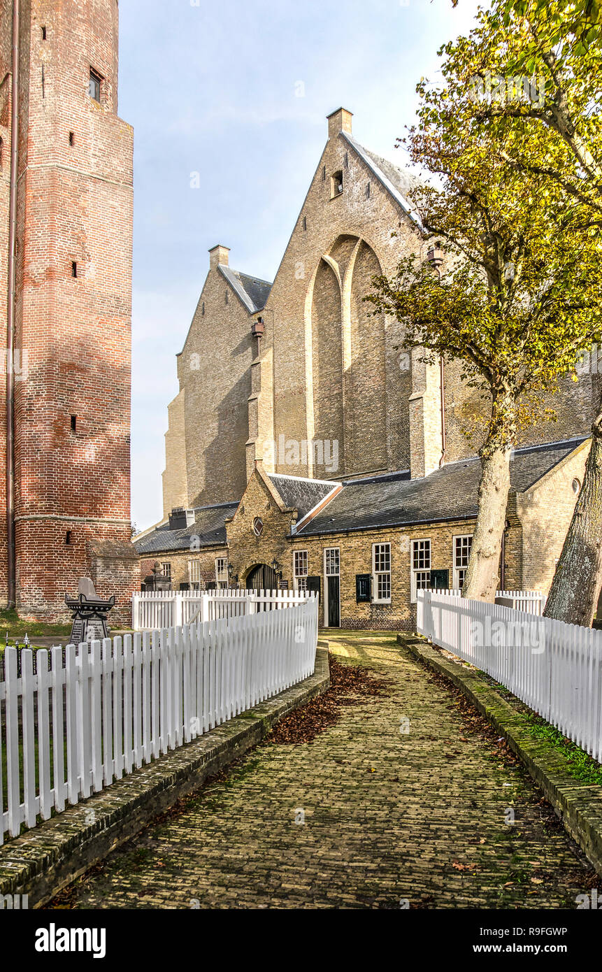 Workum, The Netherlands, November 4, 2018: footbath, lined with white fences, between the tower and the nave of Saint Gertrudis church Stock Photo
