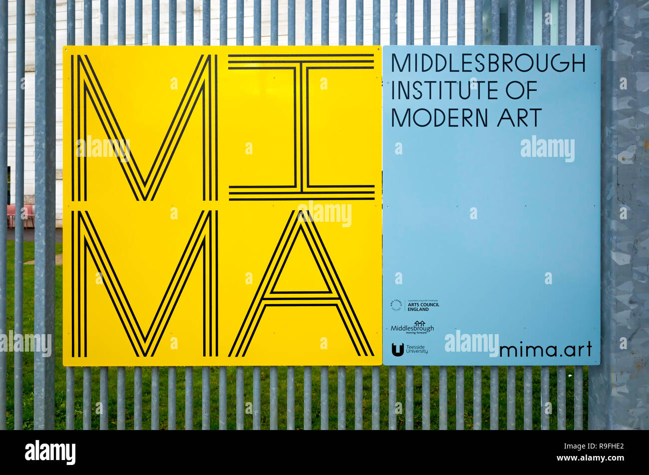 A sign for MIMA The Middlesbrough Institute of Modern Art mounted on a fence Stock Photo