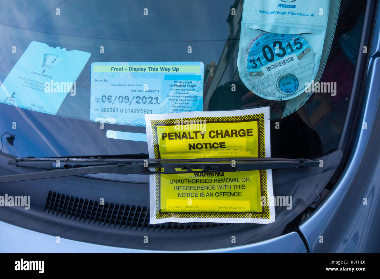 Penalty Charge Notice on a car that has a disabled badge failed to display a valid  paid parking ticket in Whitby North Yorkshire England UK - Stock Image
