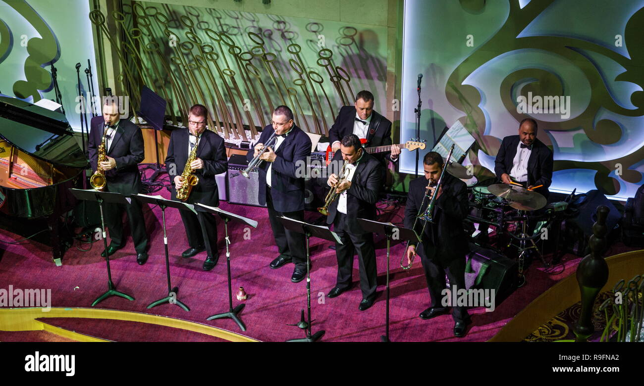 Horn Section of an Orchestra on a Cruise Ship - Stock Image