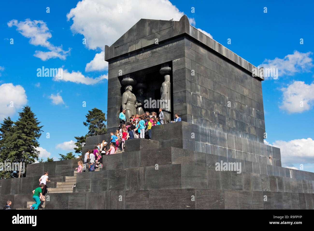 Tourists at Monument to the Unknown Hero on mountain Avala, Belgrade, Serbia - Stock Image