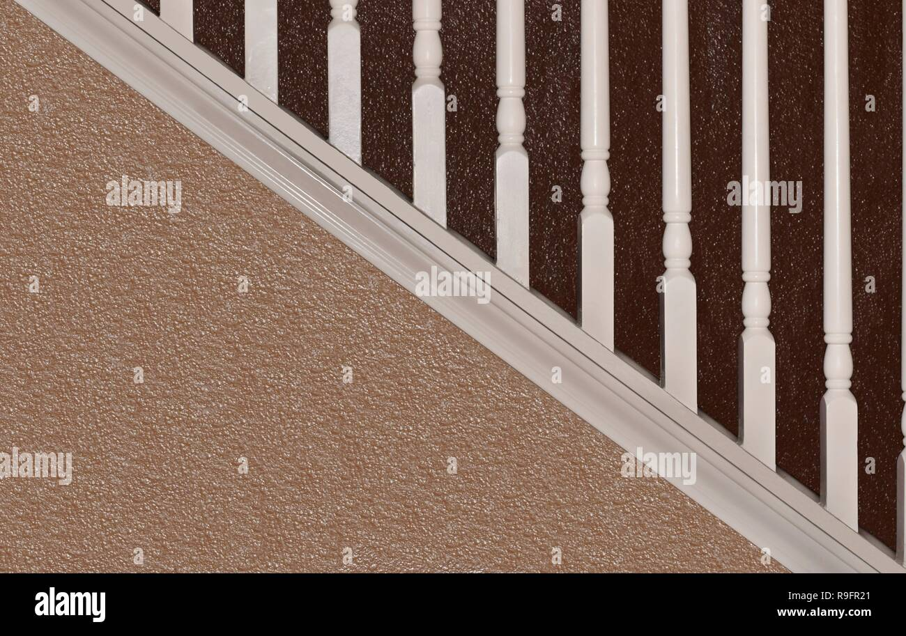 Side-view of a staircase with two-tone brown paint, showing both diagonals and verticals. - Stock Image