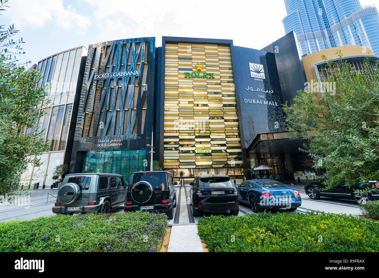 Exterior of Dubai Mall Fashion Avenue with valet parked expensive cars outside , Downtown Dubai, United Arab Emirates - Stock Image