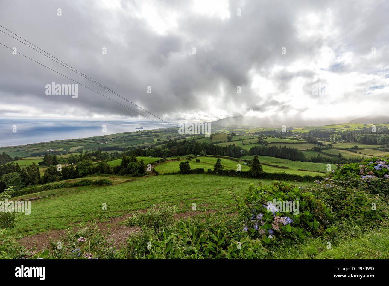Beautiful view of the dramatic cloudscape above Vila Franca do Campo on Sao Miguel, Portugal. Stock Photo