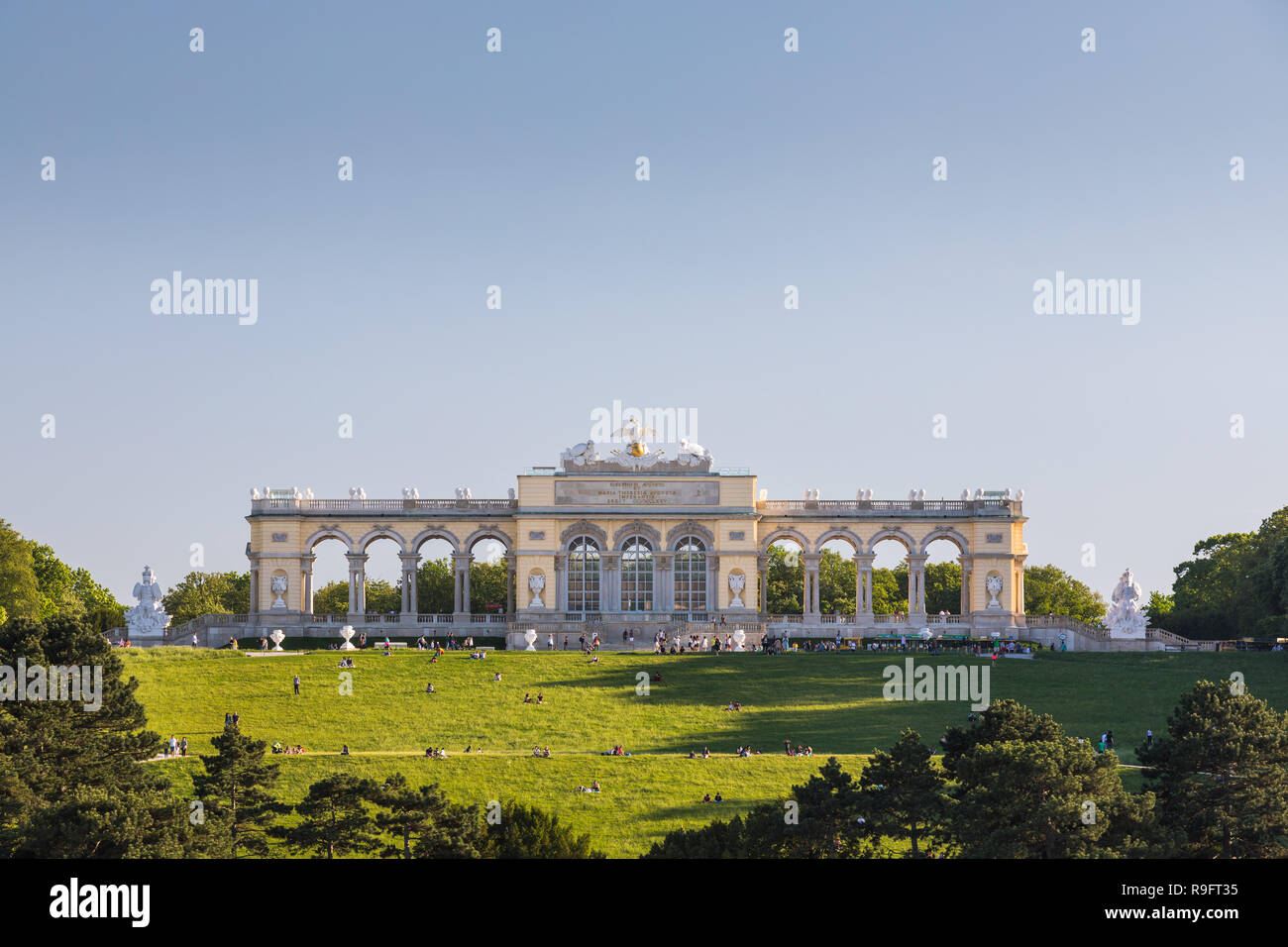 Schönbrunn Palace with the gardens with the Neptune Fountain and the Glorietter was the main summer residence of the Habsburg rulers, it is located i - Stock Image