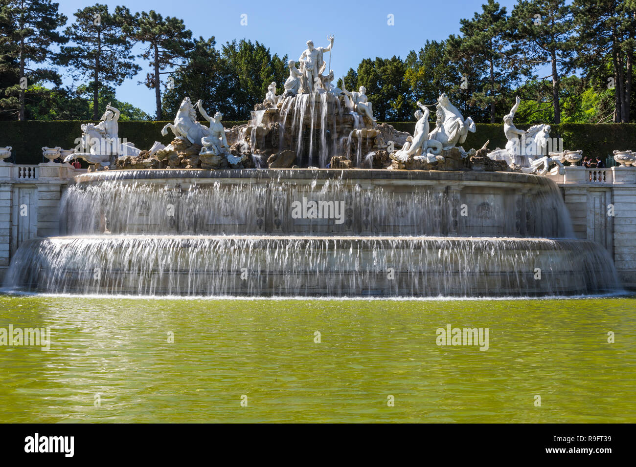 Schönbrunn Palace with the gardens with the Neptune Fountain and the Glorietter was the main summer residence of the Habsburg rulers, it is located in - Stock Image