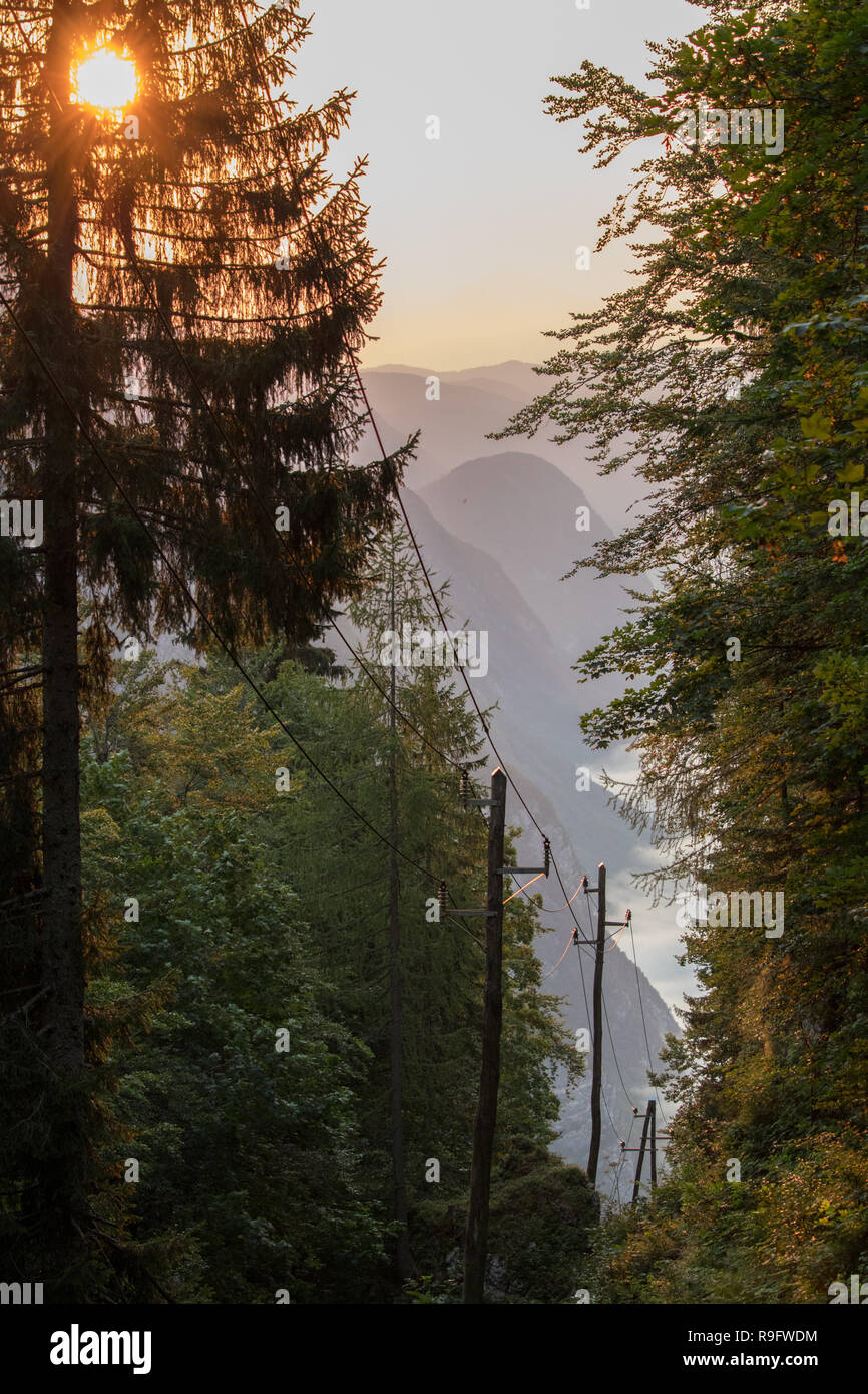 electric tower early in the morning in mountains - Stock Image