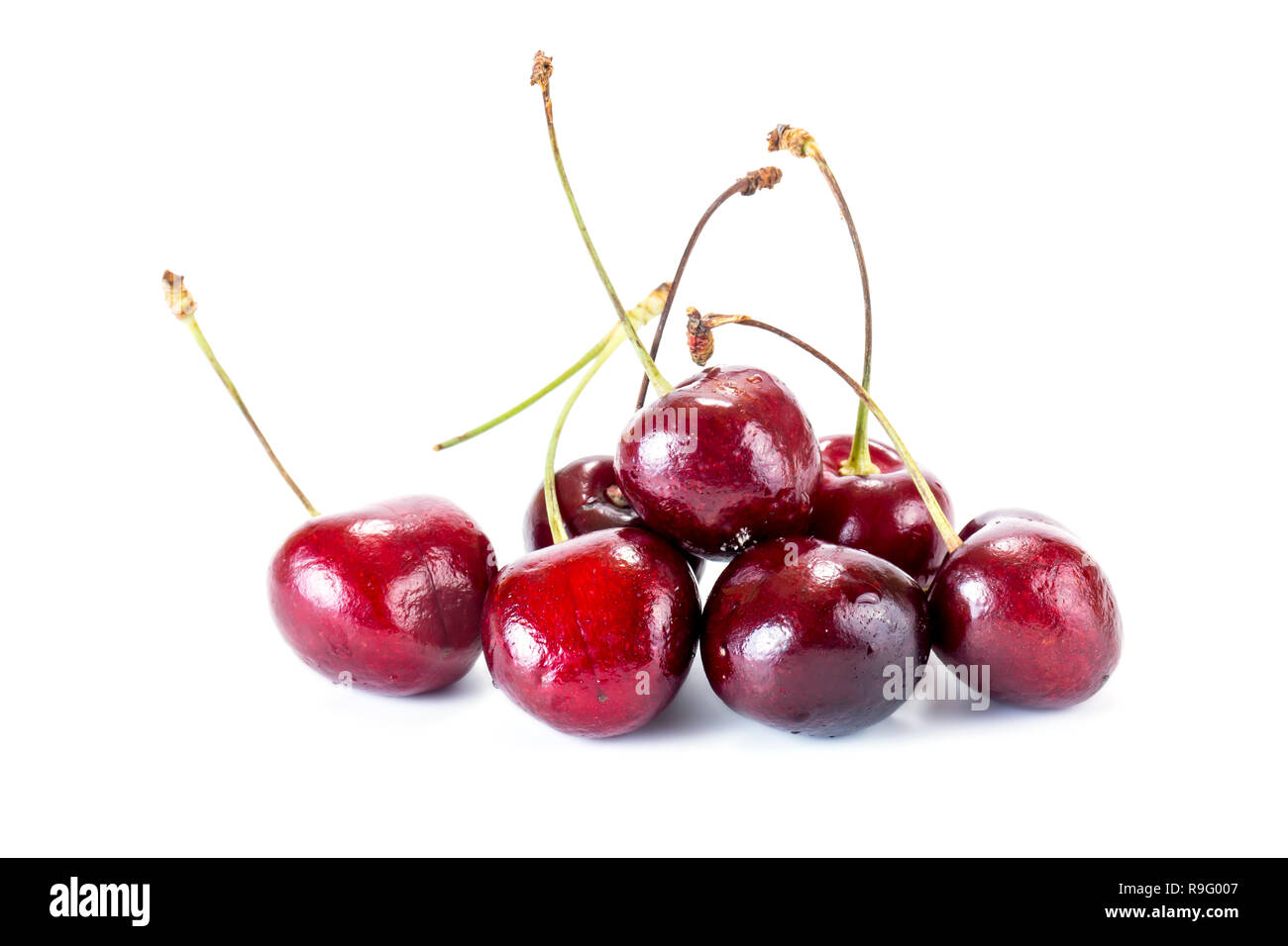 Ripe berry of sweet cherry it is isolated on a white background - Stock Image