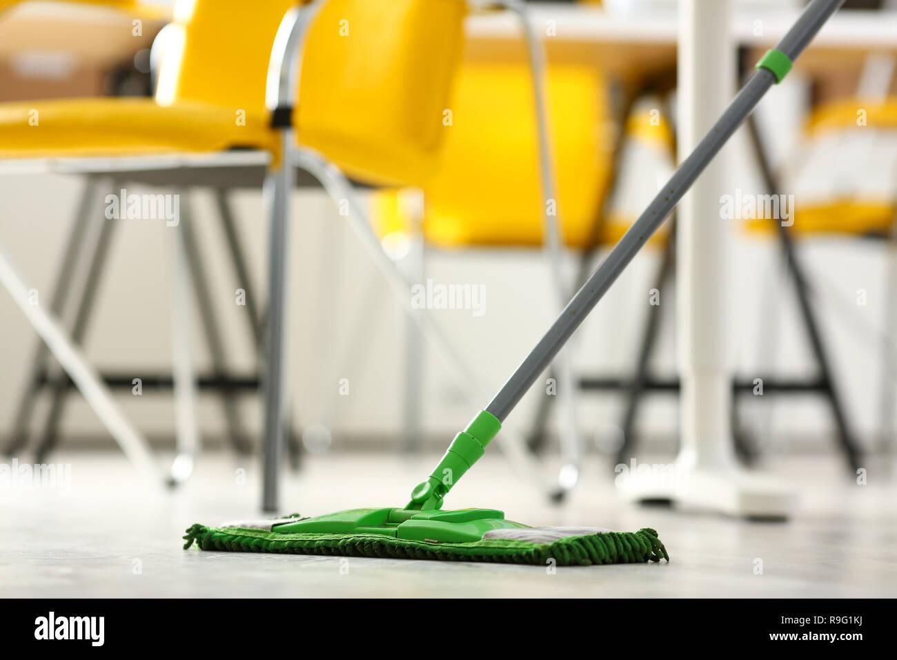 Green plastic mop - Stock Image