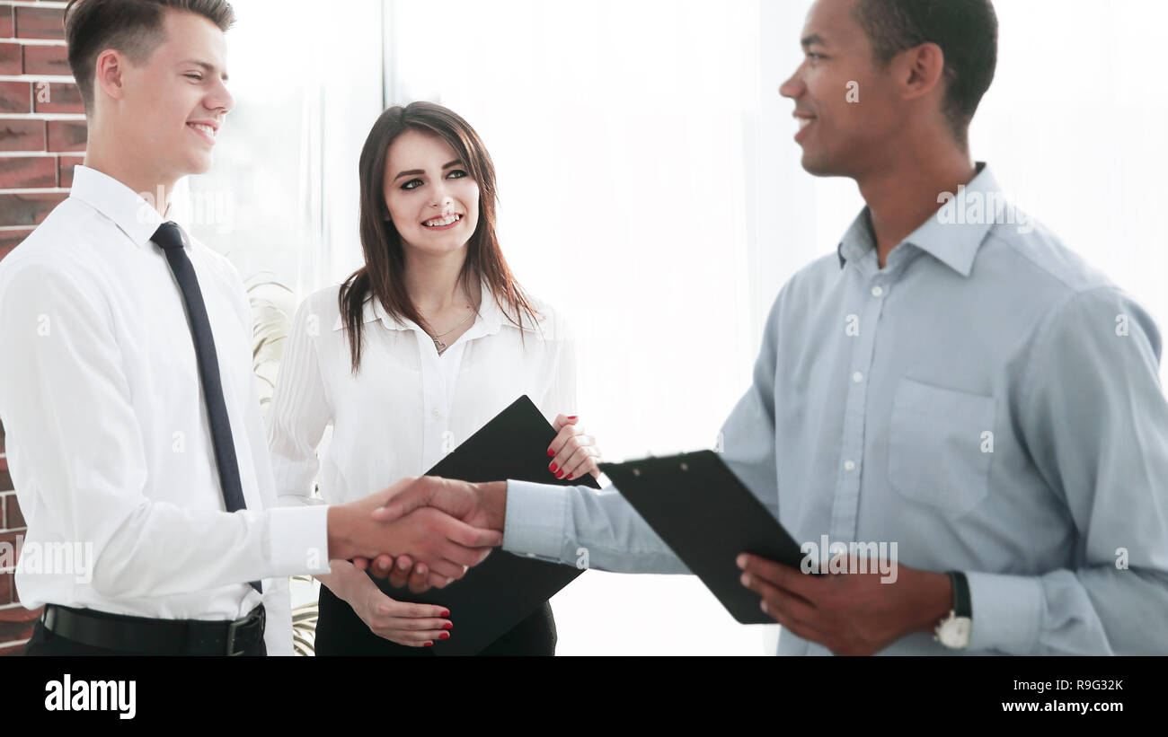 handshake of young business partners in the office Stock Photo