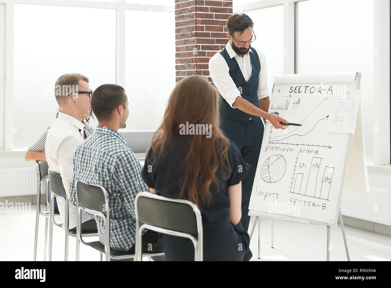 group of business people at a business presentation - Stock Image