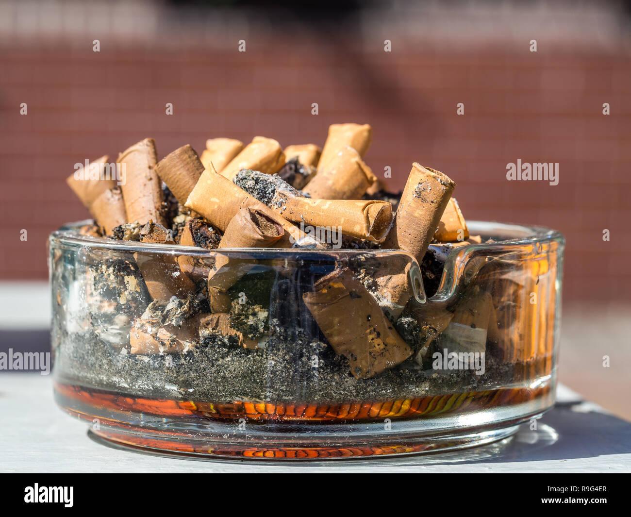 Ashtray symbolic picture - Stock Image
