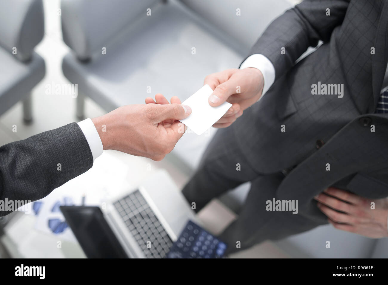 business partners exchanging business cards - Stock Image