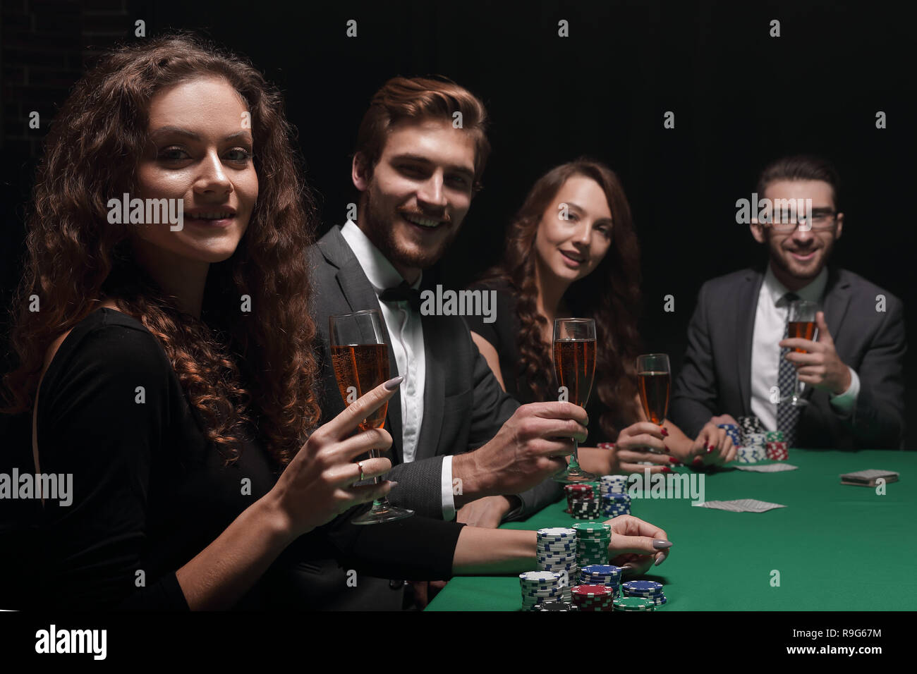 beautiful woman sitting at a table in a casino - Stock Image