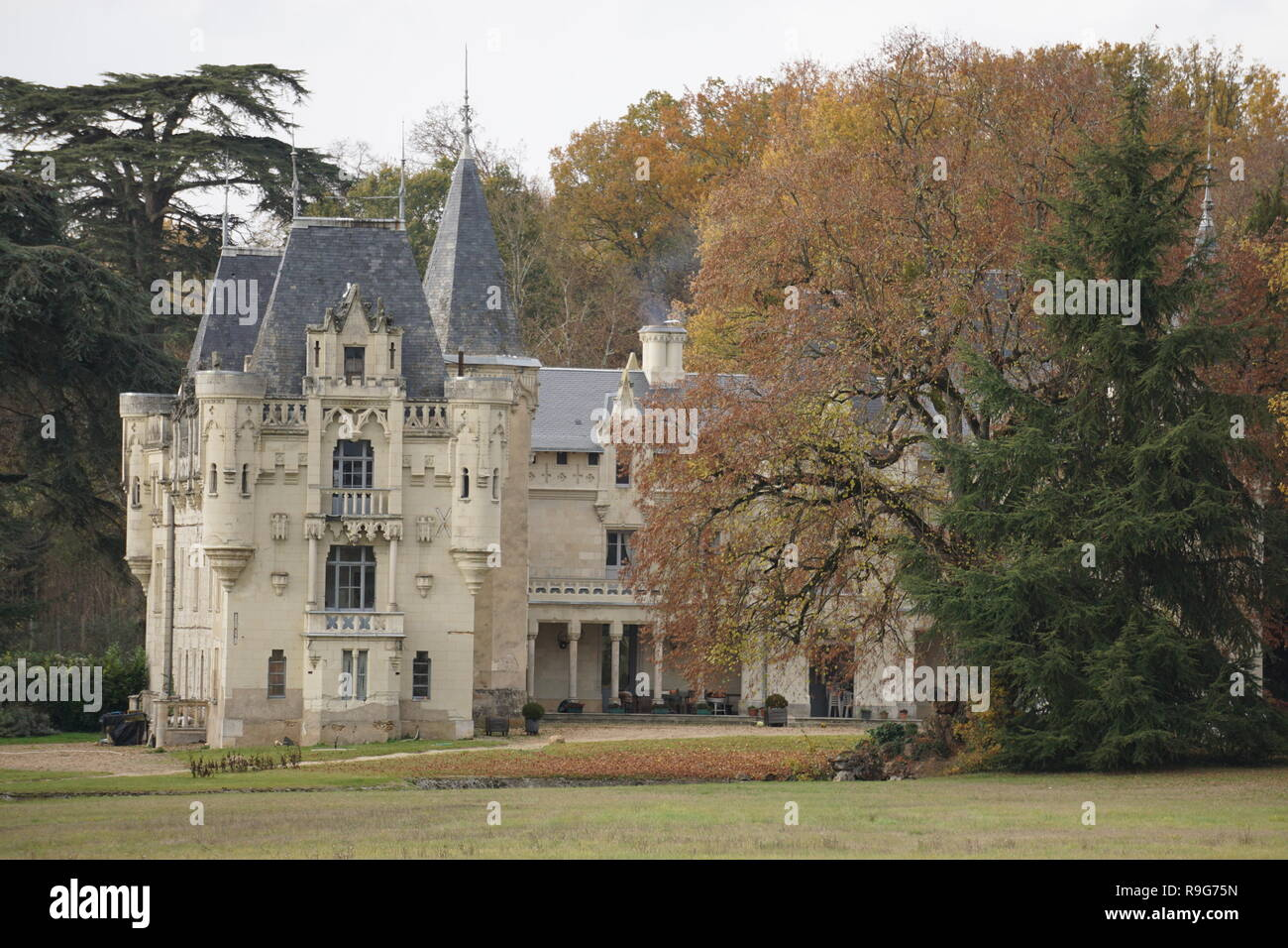Beautiful remodeled old limestone castle in the park in the Loire Valley, France on a fall day Stock Photo