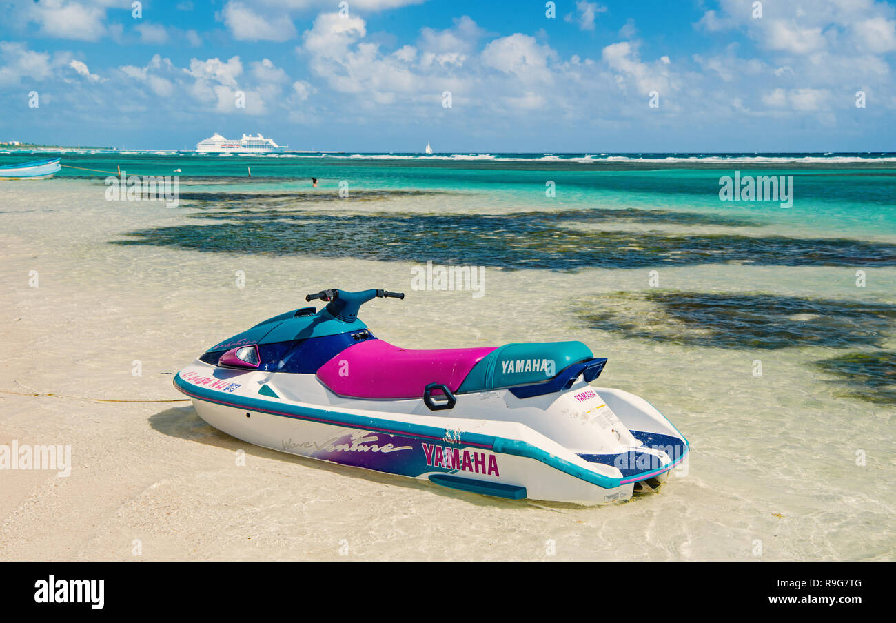 Costa Maya, Mexico - February 01, 2016: watercraft yamaha on clear sea or ocean water with white sand on sunny day on cloudy blue sky. Recreation, sport, activity. Summer vacation, travelling concept. - Stock Image