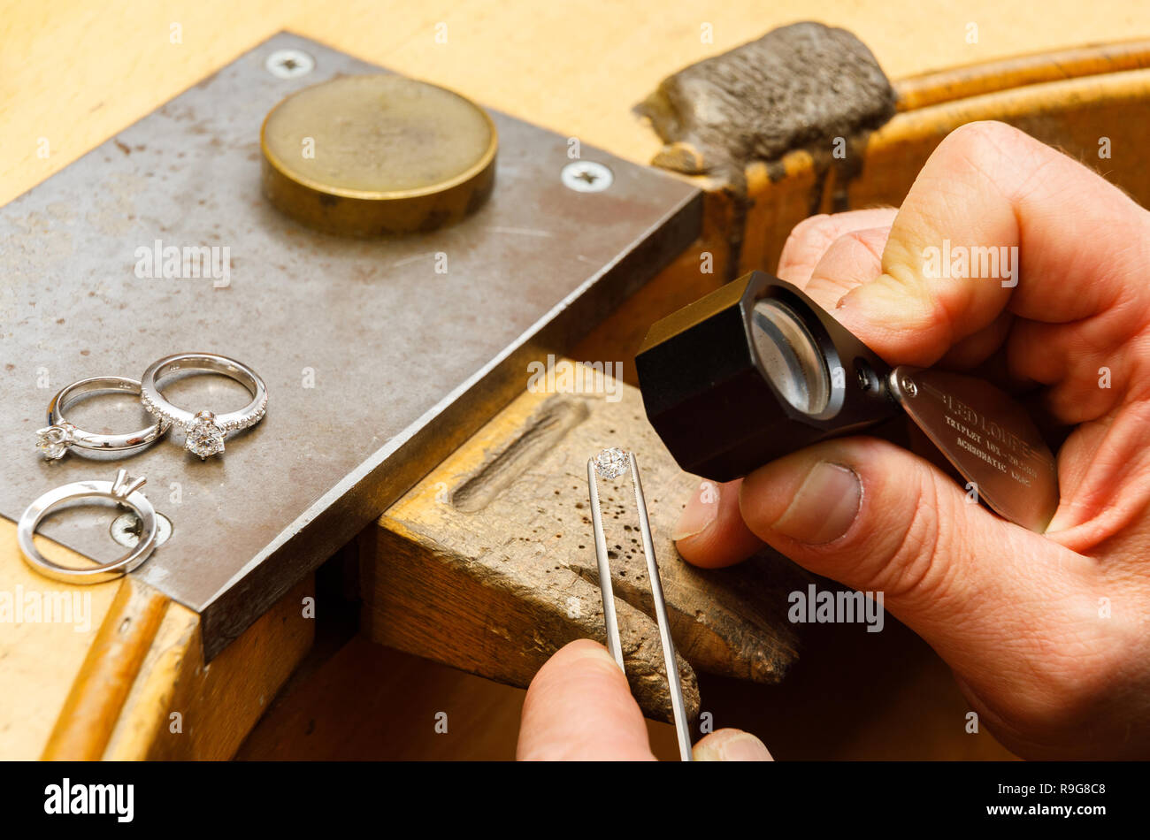 hands of a jeweler working with a diamond - Stock Image