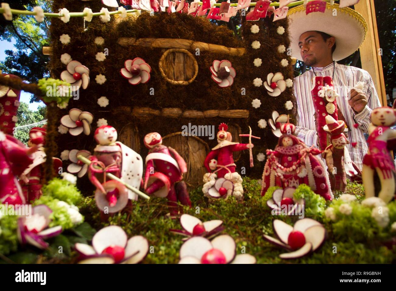 View of figures made with radishes in the state of Oaxaca, Mexico, 23 December 2018. Artisans carve and mold figures made with tubers to expose them in the traditional Night of Radishes, which has been held for 121 years in the city of Oaxaca, in southern Mexico. This peculiar custom started in 1897 when a contest was established where horticulturists and floriculturists brought their products. The craftsmen take advantage of the different forms that the tubers adopt to elaborate pieces that represent Christmas scenes, illustrious personages, dances, and a varied type of representations dictat - Stock Image