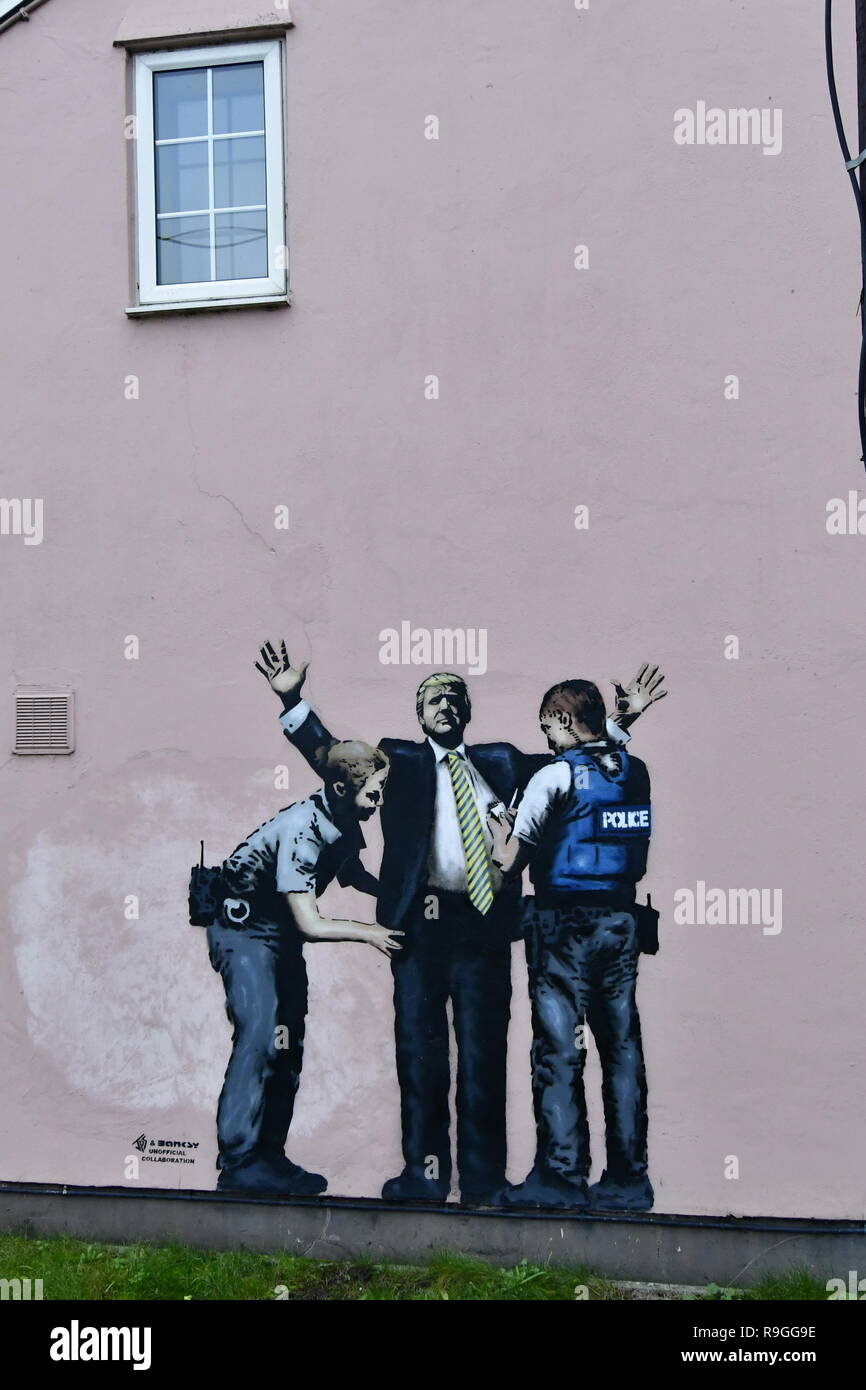 Weston Super Mare, UK. 24th Dec, 2018. Is this another Banksy ? Looks like Donald Trumps been in seen and searched by poliice on the front wall of a house on the main Weston Super Mare Road. Credit: Robert Timoney/Alamy Live News - Stock Image