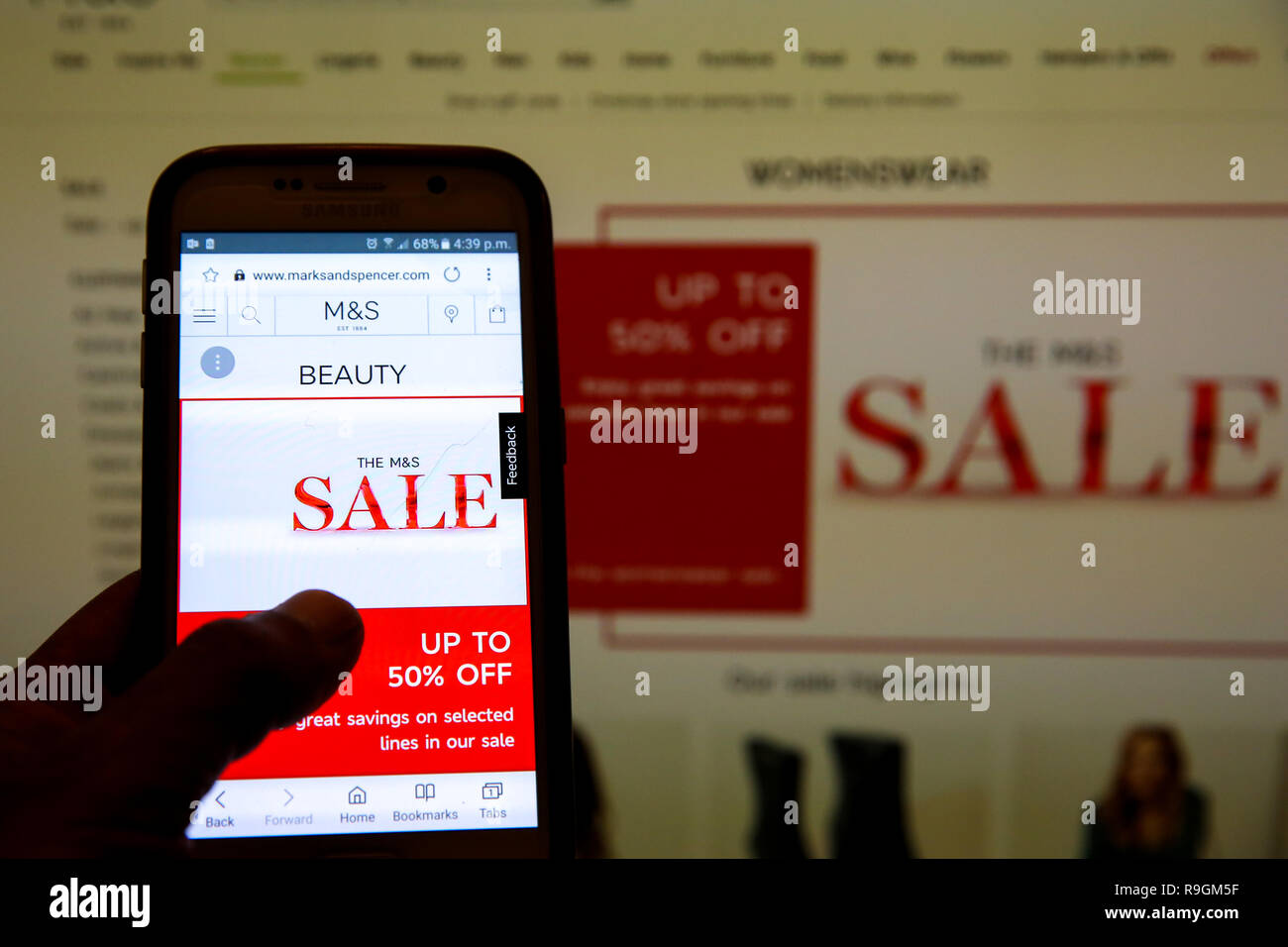 405ac03ac0 Marks   Spencer Boxing Day online sale is seen on a mobile phone. Boxing Day