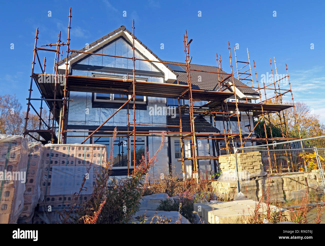 Detached House under construction, scaffolding, Eskbank, Dalkeith, Midlothian, near Edinburgh, Scotland, UK Stock Photo