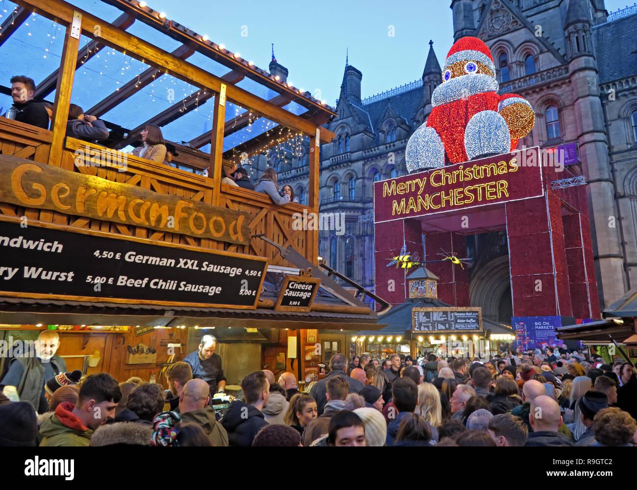 German Food, Christmas markets, Albert Square, Manchester, Lancashire, north West England, UK, at dusk Stock Photo