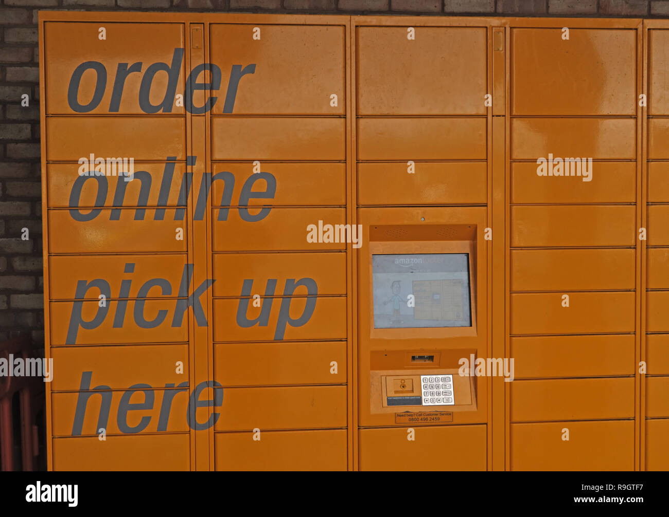 Orange Amazon lockers, Order Online, Pick Up Here, Taunton Morrison's supermarket, Somerset, South West England, UK - Stock Image