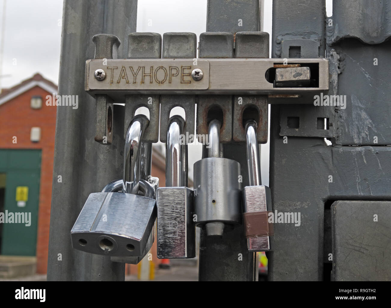 Secure gates, gate security using multiple locks and padlocks, Tayhope Multi-lock system, on a sub-station gate, Western Power distribution,Bridgwater - Stock Image
