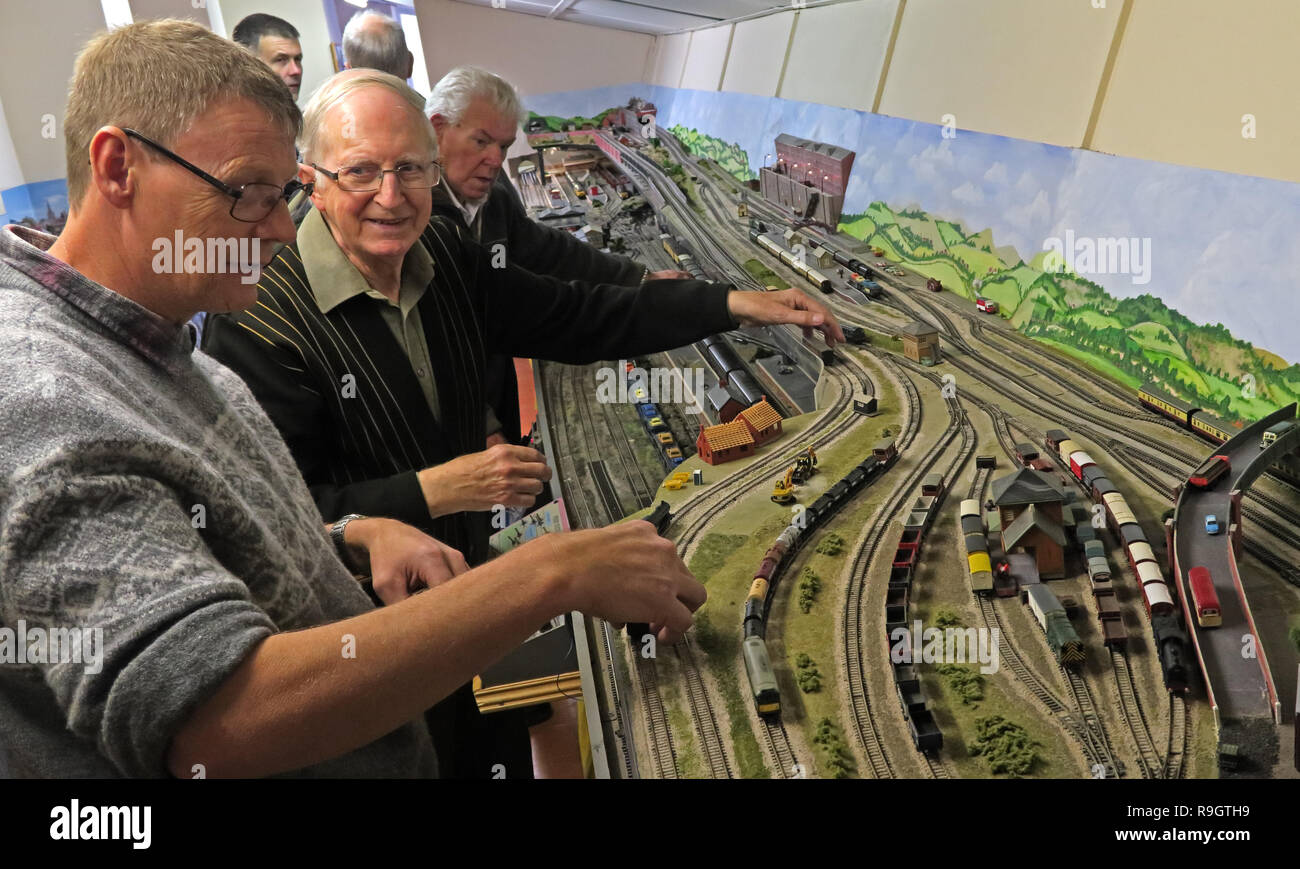 Railway model enthusiasts operate a large layout at a club, Grappenhall, South Warrington, Cheshire, North West England, UK, WA4 2SG - Stock Image