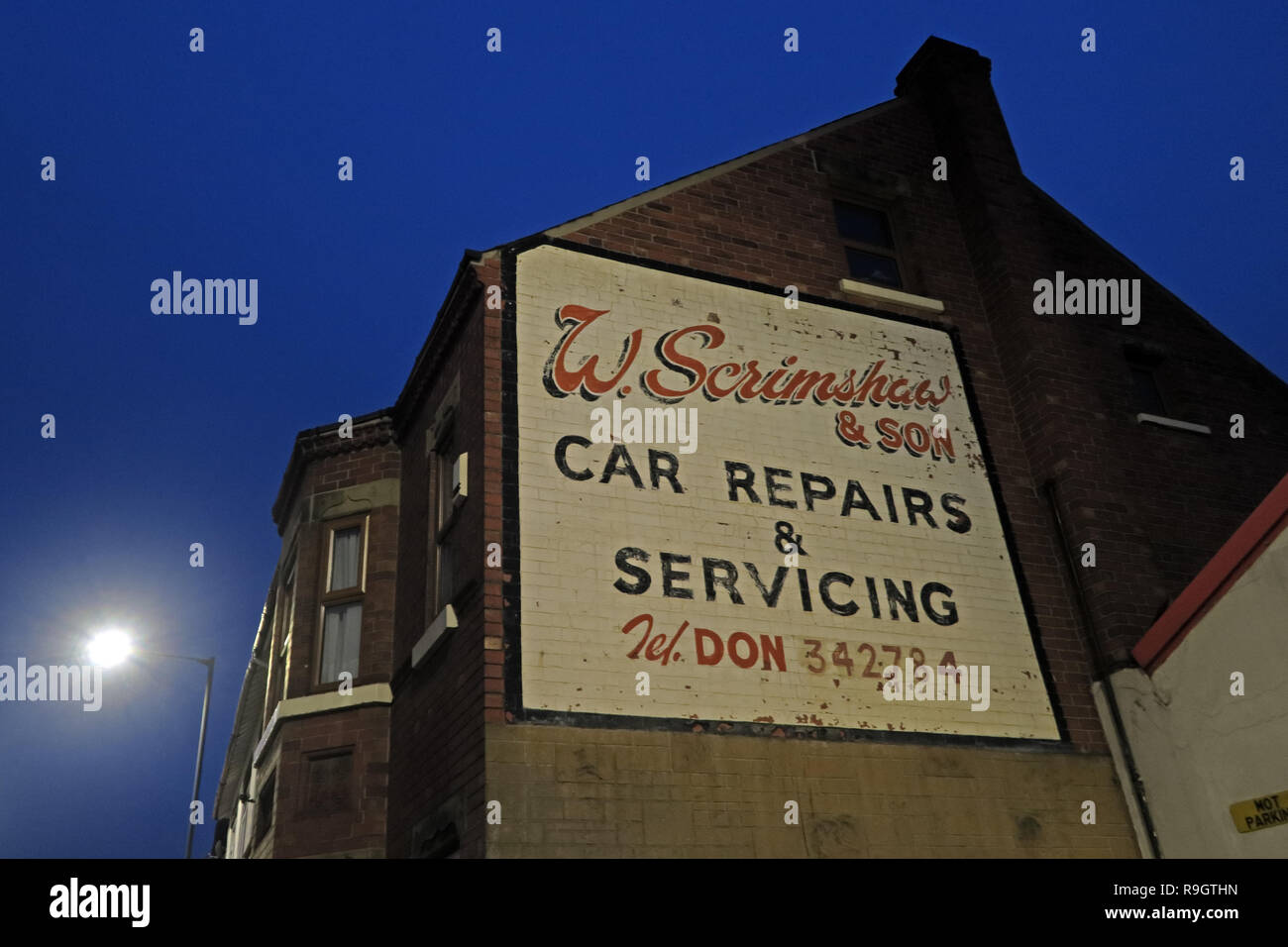 W.Scrimshaw and son, Car Repairs and Servicing, Don 342784, Balby Rd, Doncaster, South Yorkshire, England, UK,  DN4 0RE at dusk - Stock Image