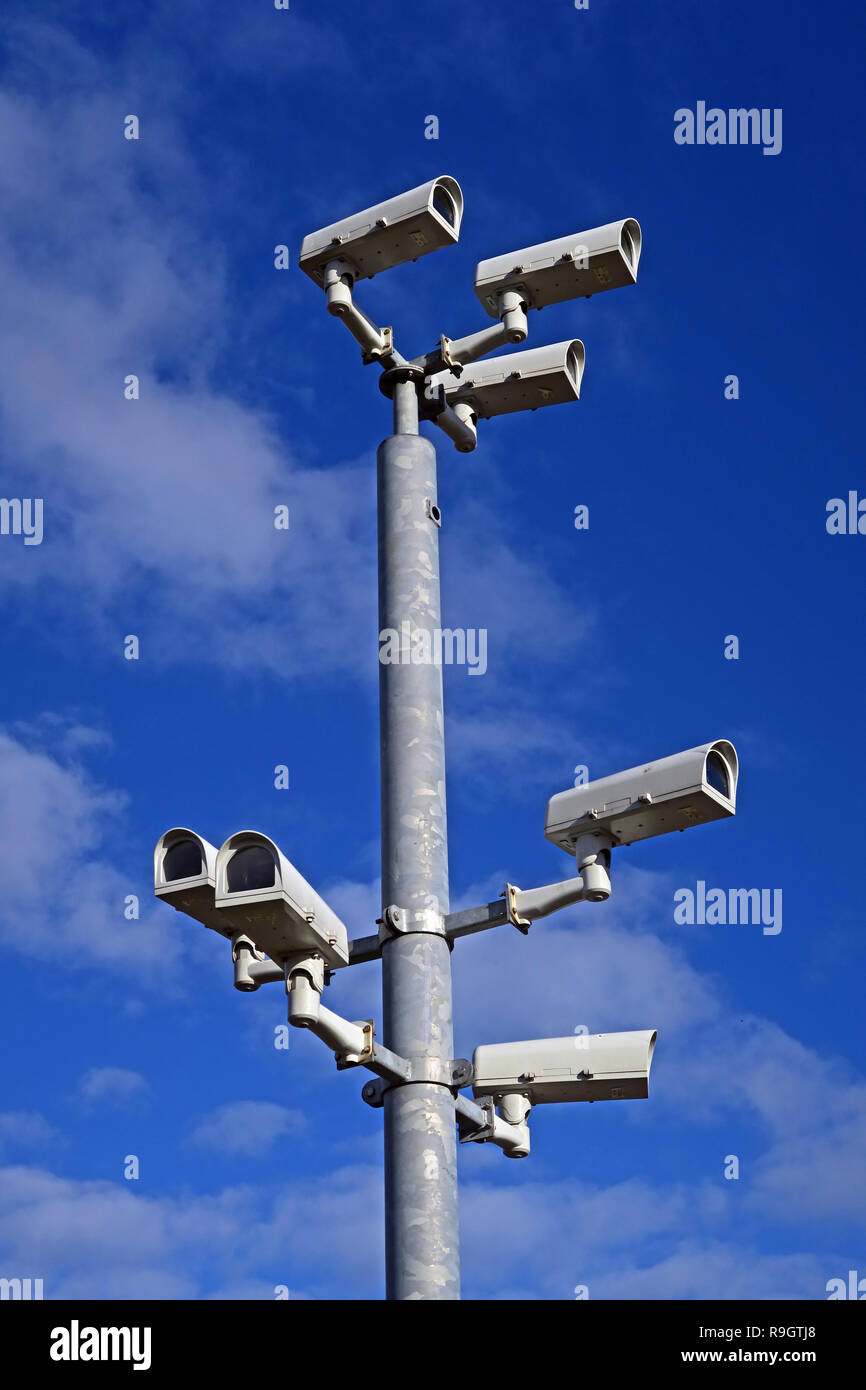Seven Security Surveillance Closed Circuit AI Cameras, on a pole in a town centre, UK - Stock Image
