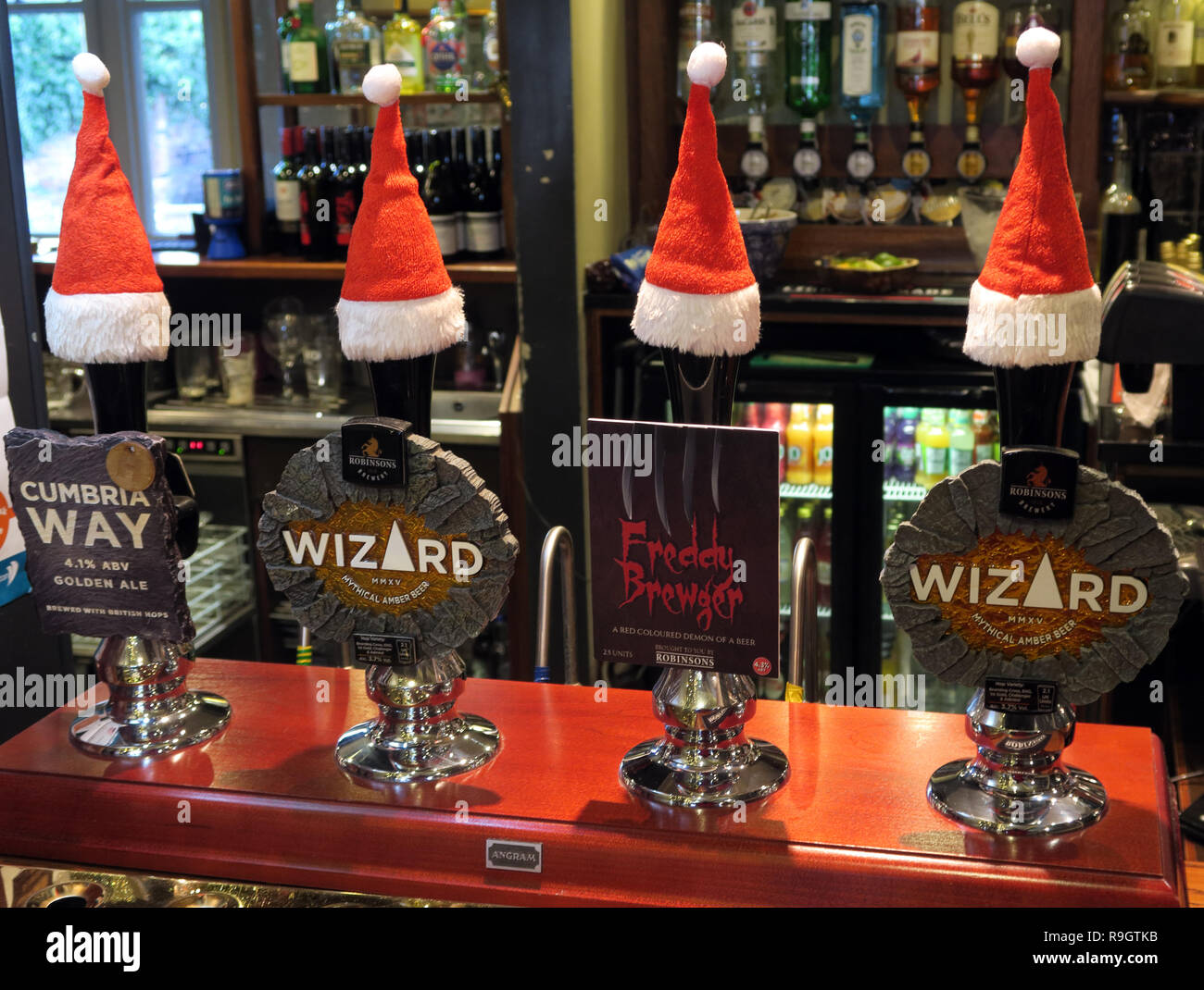 Robinsons brewery Stockport, bar of Real Ale Pumps, with Xmas hats, Cumbrian Way, wizard, Freddy Brugar, on a bar, Parr Arms, Grappenhall, Warrington - Stock Image