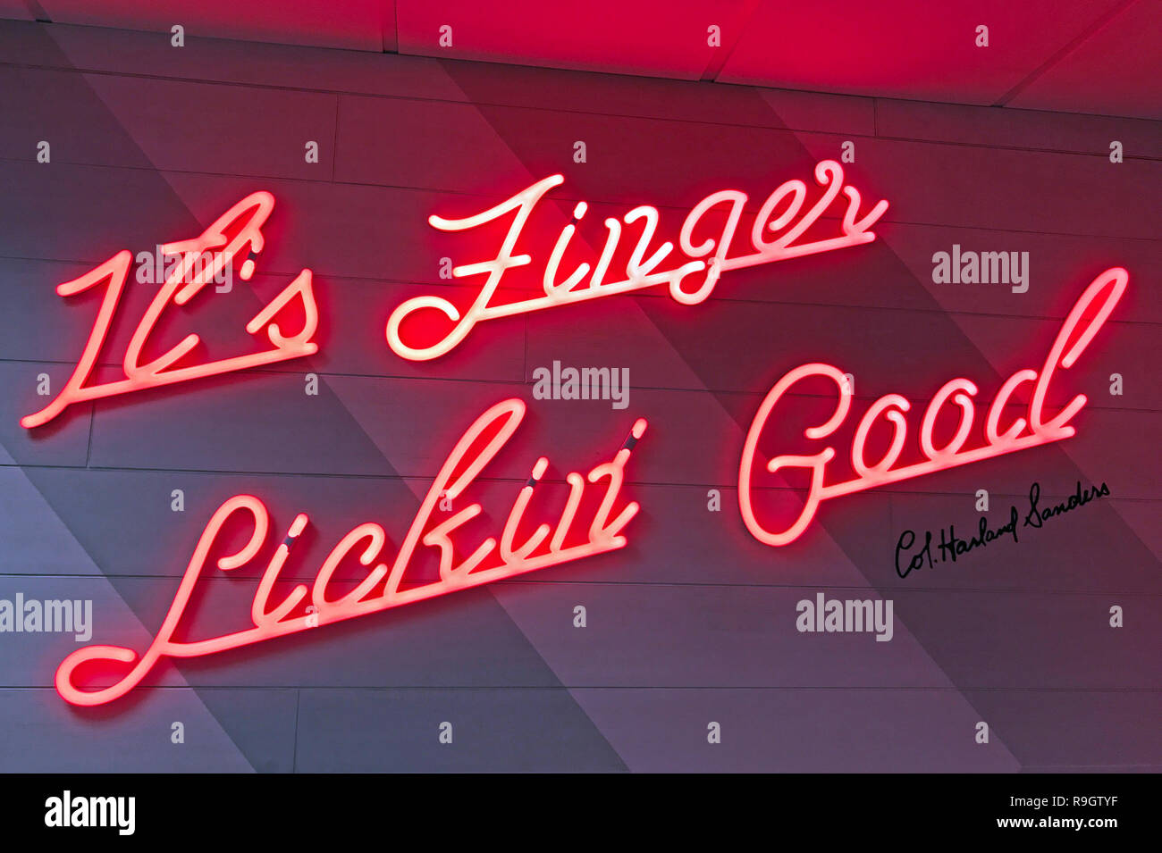 Its Finger Licking Good, Red Neon KFC Logo, Fried Chicken on a wall - Stock Image