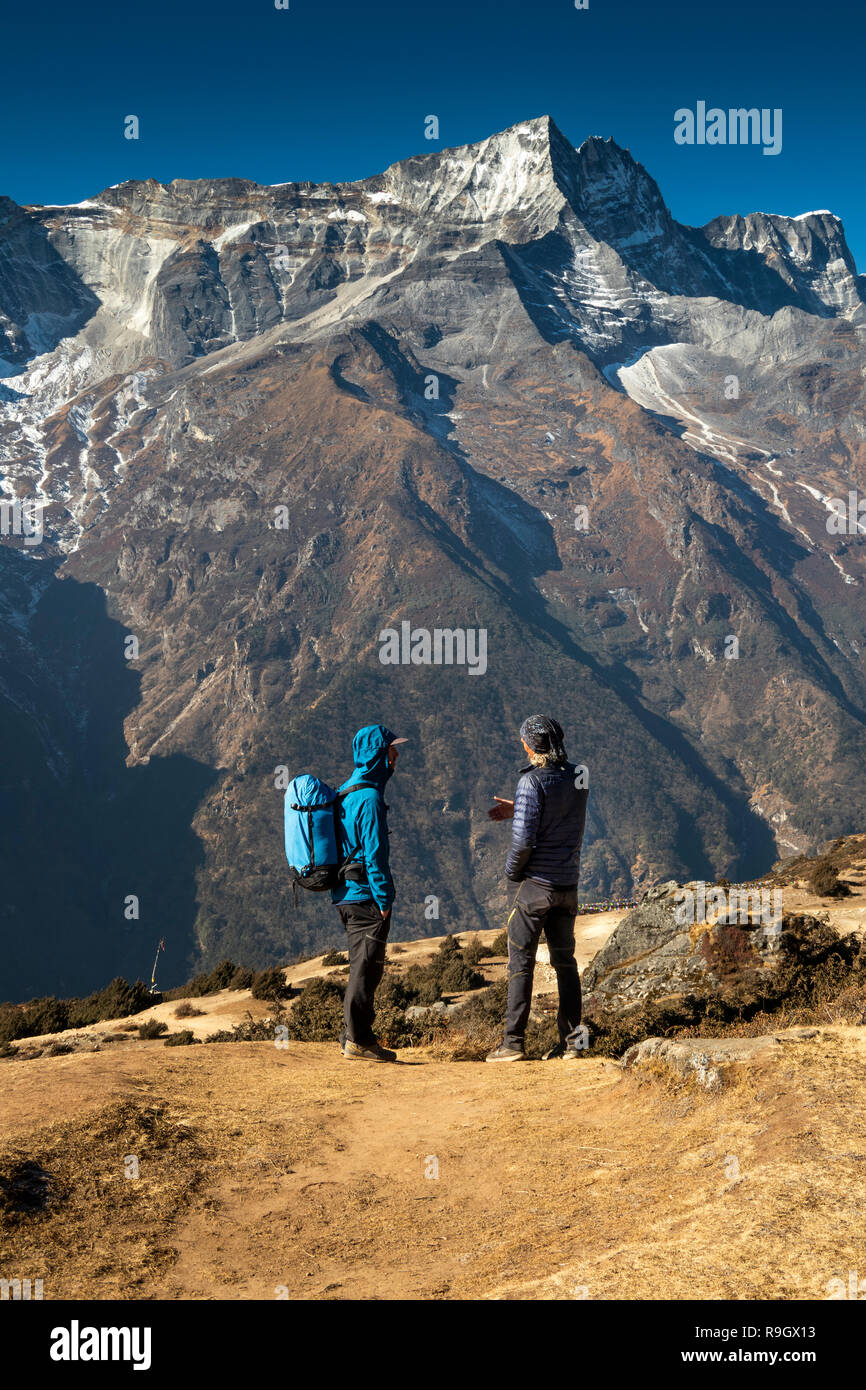 Nepal, Namche Bazar, two trekkers on path up to Namche Bazaar airfield opposite Kongde Ri Stock Photo