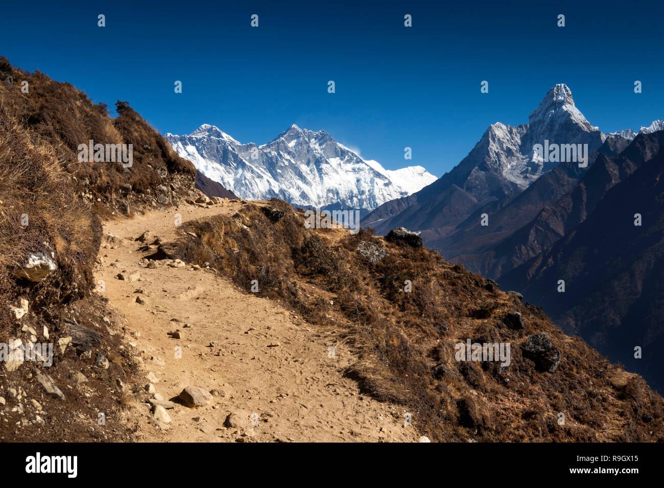 Nepal, Everest Base Camp Trek, panoramic view of Everest and surrounding Himalayan mountains from path - Stock Image