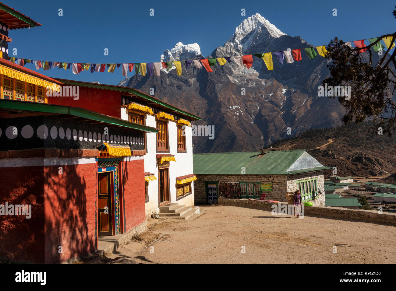 Nepal, Everest Base Camp Trek, Khumjung, traditional village gompa with view of Hongku snow capped peak - Stock Image