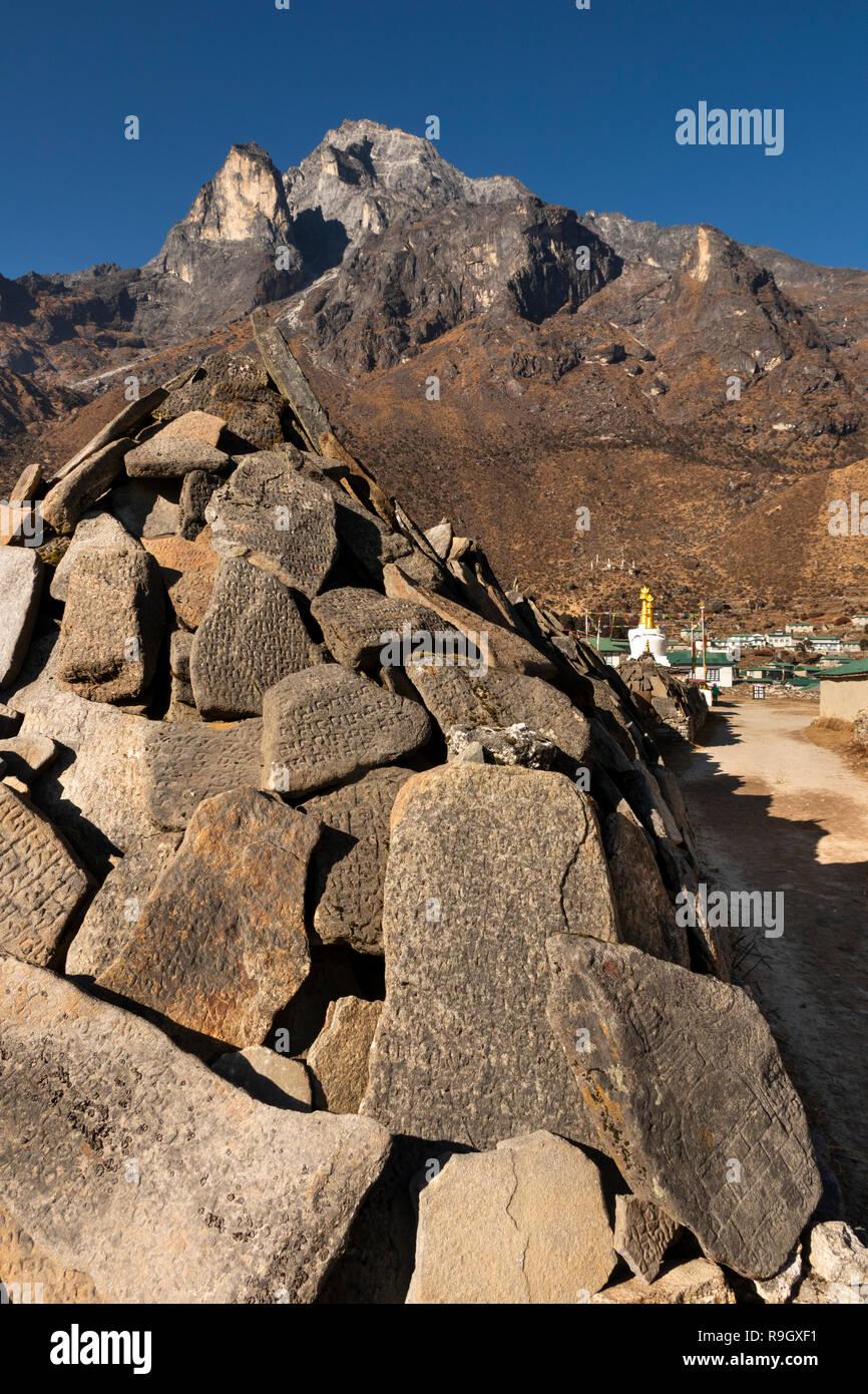 Nepal, Everest Base Camp Trek, Khumjung, traditional carved mani stones below Mount Thame (3650m) - Stock Image