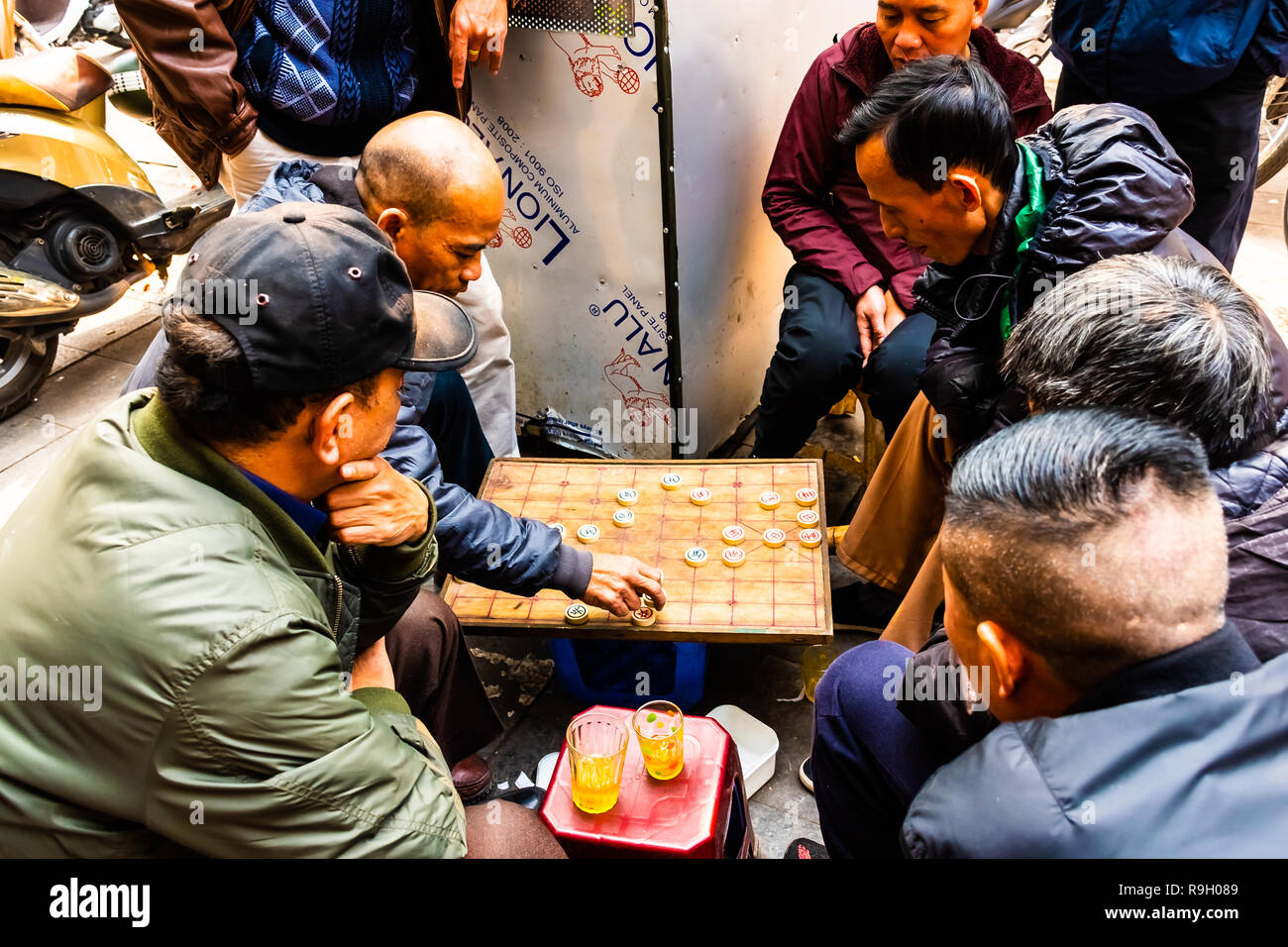 Hanoi, Vietnam - Feb 13 2018 : Two men playing strategic board game for two players called go in the streets of Hanoi. Stock Photo