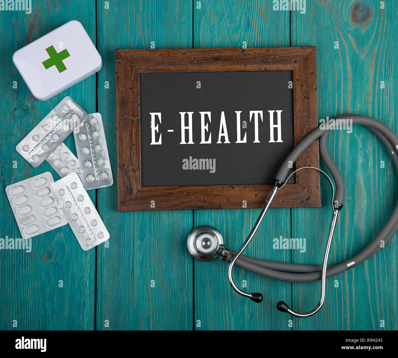 "Medecine concept - Blackboard with text ""E-health"" and stethoscope on blue wooden background Stock Photo"