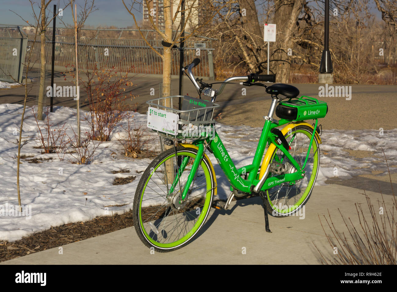 Green bike sharing service launched as part of a pilot project in Calgary, Alberta, Canada - Stock Image