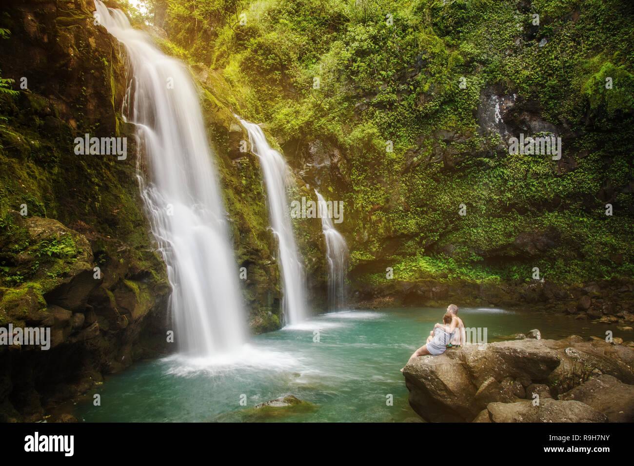 Upper Waikani Falls Hawaii couple in love romantic getaway - Stock Image