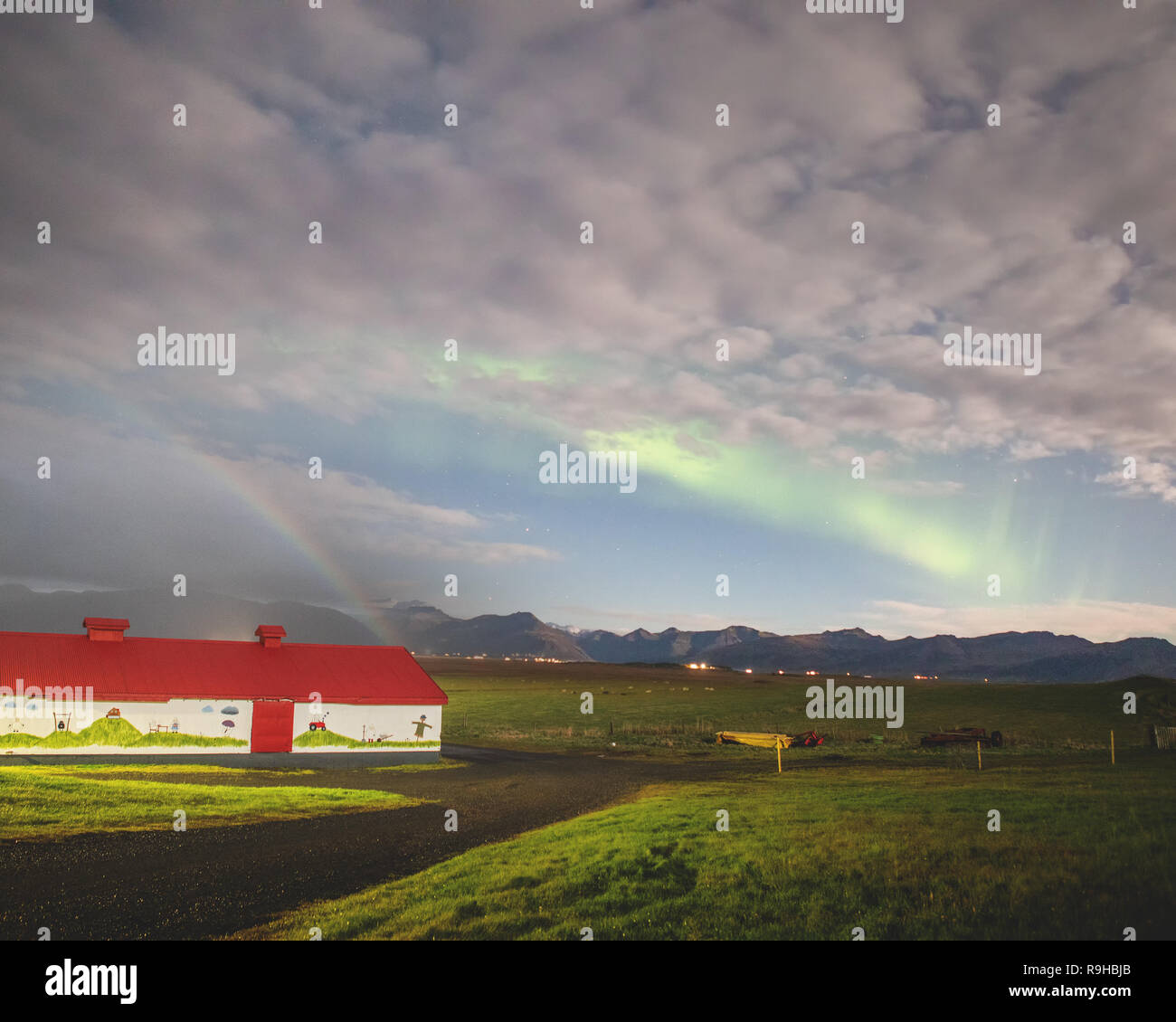 Moon light ranbow moonbow and aurora borealis northern lights country side rural farm Iceland - Stock Image
