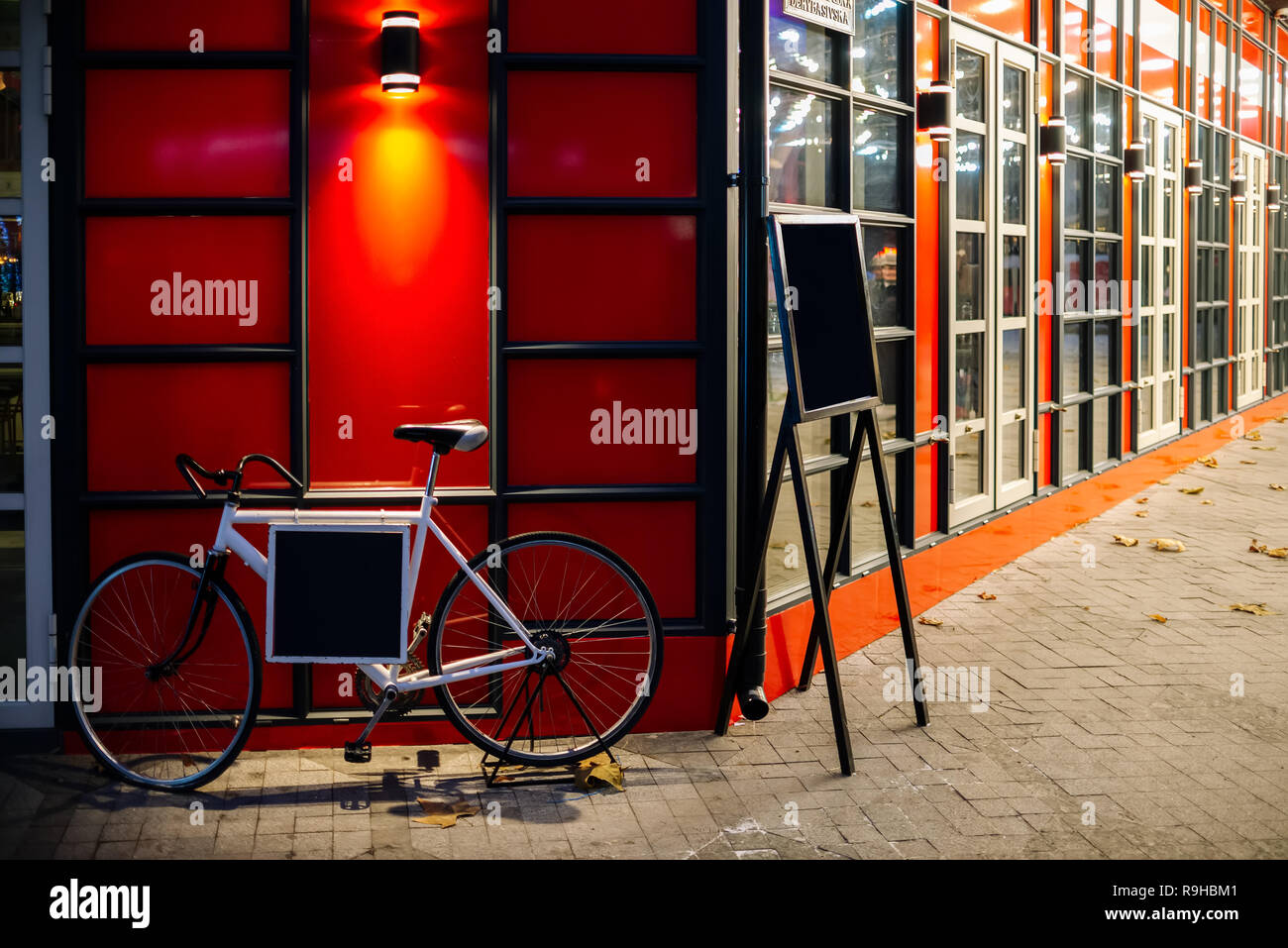 Red Retro Bicycle With And Post Box In Front Of The Multi Color