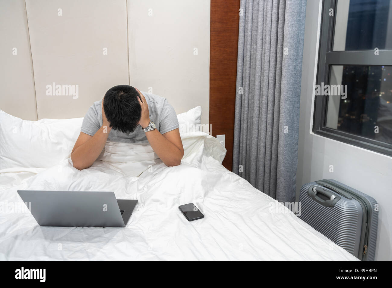Asian businessman feel headache in the stressful business trip - Stock Image