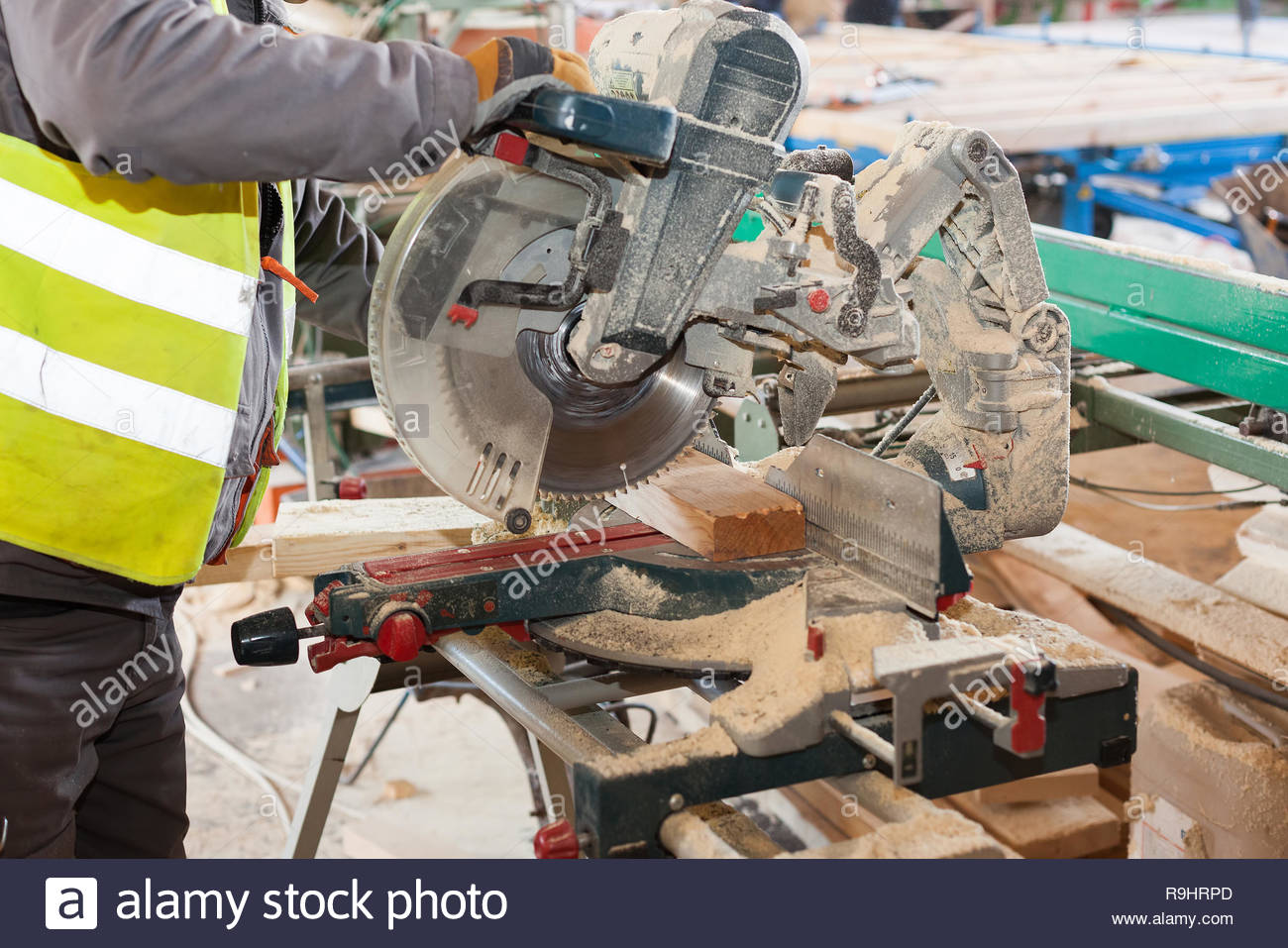 Carpenter Using Miter Saw Stock Photos Carpenter Using Miter Saw