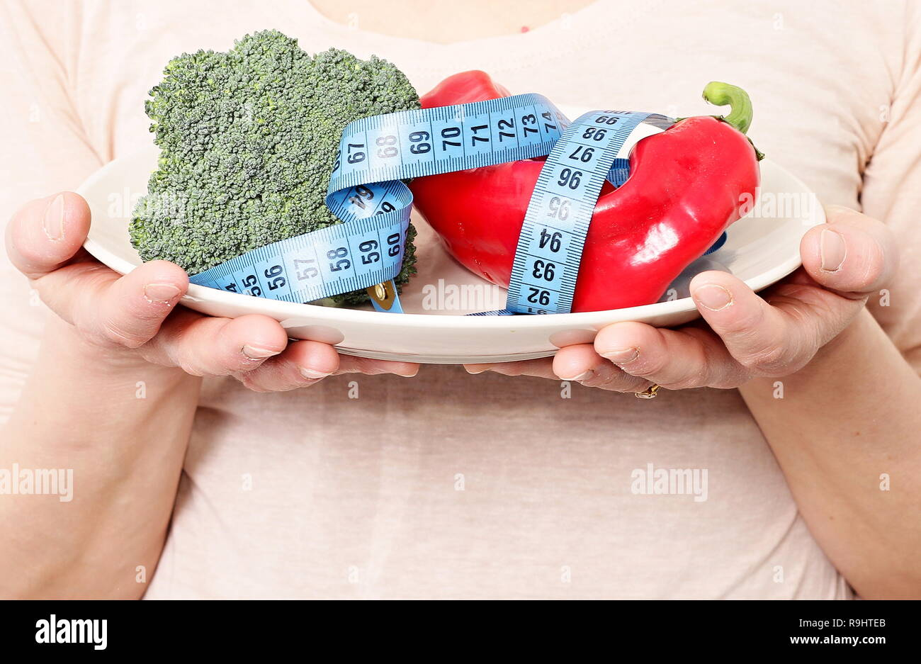 Awe Inspiring Healthy Vegetables On The Plate With Tape Measure Download Free Architecture Designs Scobabritishbridgeorg