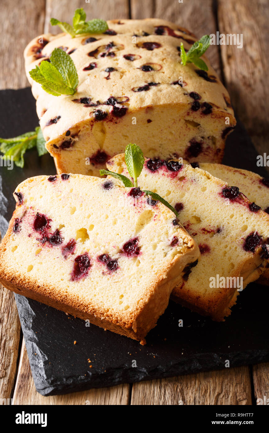 Rustic sweet black currant cake close-up on the table. vertical Stock Photo