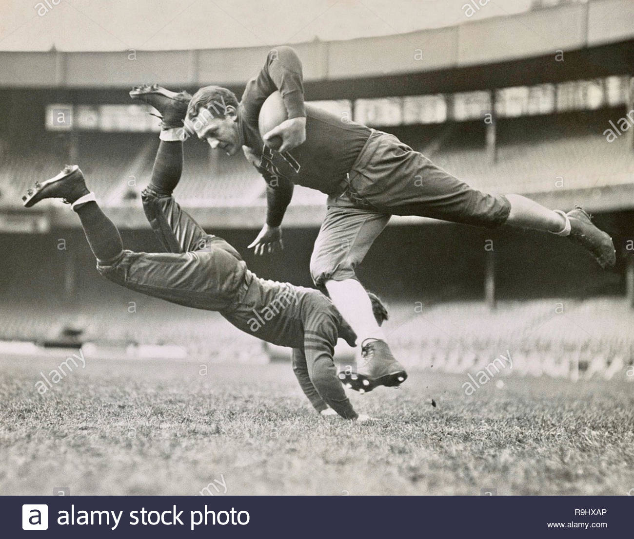 Chicago Bears teammates practicing as Joe Zeller tries to tackle Red Grange. 18 March 1935.. - Stock Image