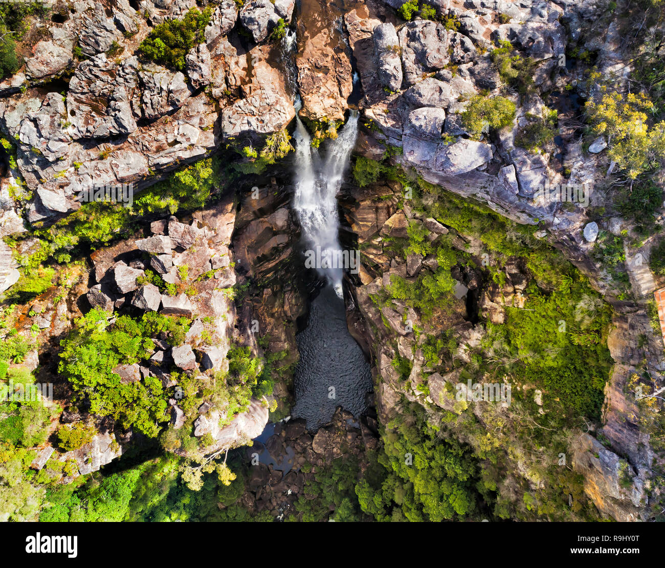Two streams of Carrington fall on Kangaroo river flowing down to Kangaroo valley in Budderoo national park seen from above top down. - Stock Image